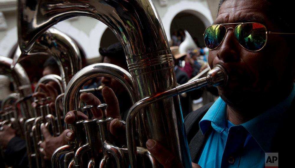 In this Feb. 10, 2018 photo, musicians perform during Carnival, in Oruro, Bolivia. (AP Photo/Juan Karita)