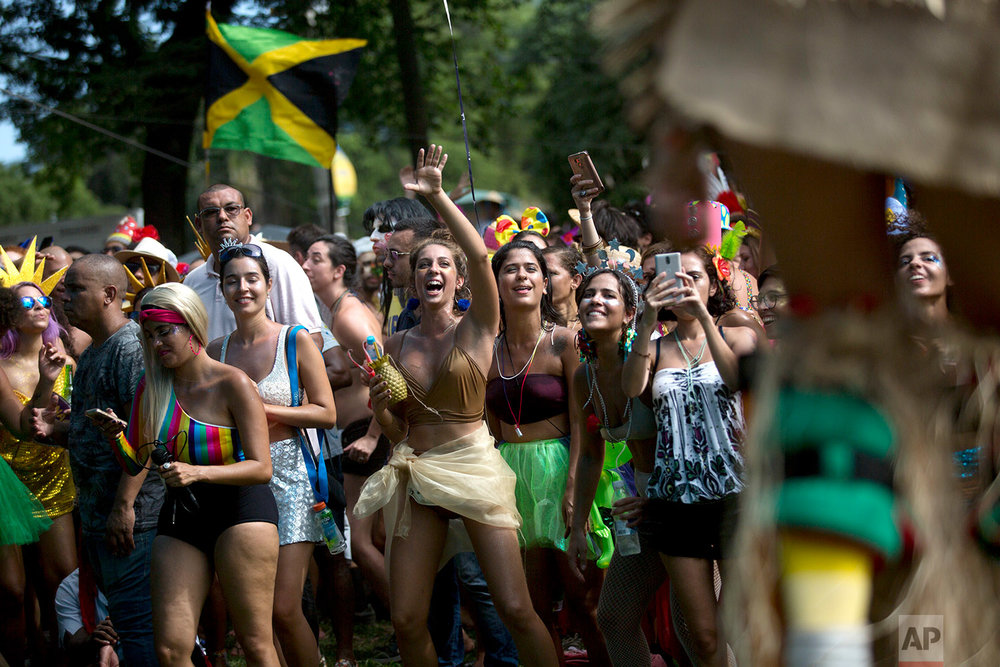 In this Feb. 10, 2018 photo, people take part in the Terreirada Cearense street carnival party in Rio de Janeiro, Brazil. (AP Photo/Silvia Izquierdo)