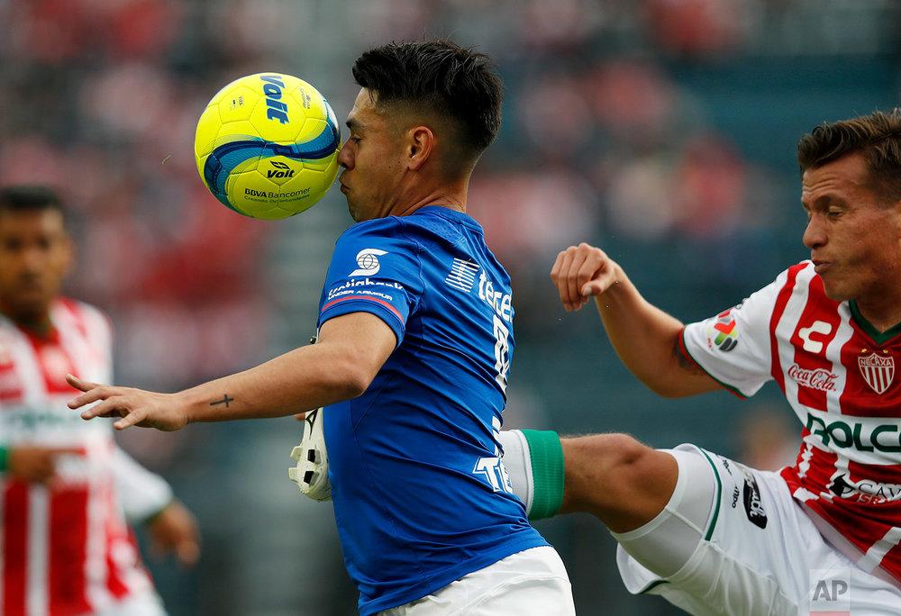 In this Feb. 10, 2018 photo, Cruz Azul's Felipe Mora gets to the ball first against Necaxa's Mario De Luna, during a Mexico soccer league match in Mexico City. (AP Photo/Eduardo Verdugo)
