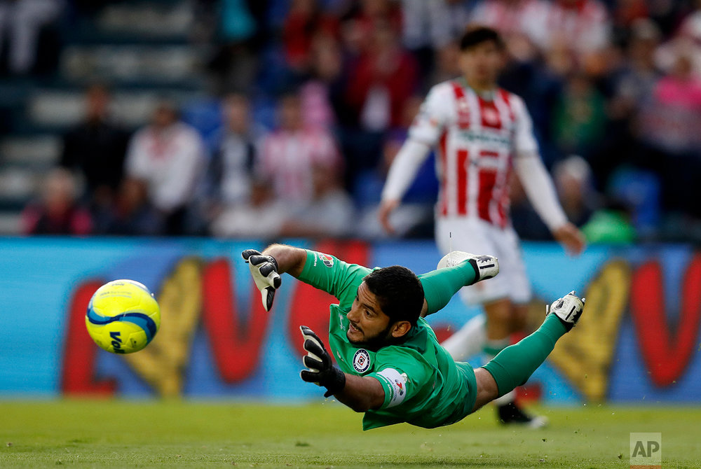 In this Feb. 10, 2018 photo, Cruz Azul goalkeeper Jesus Corona fails to stop the shot by Necaxa's Carlos Gonzalez during a Mexico soccer league match in Mexico City. (AP Photo/Eduardo Verdugo)