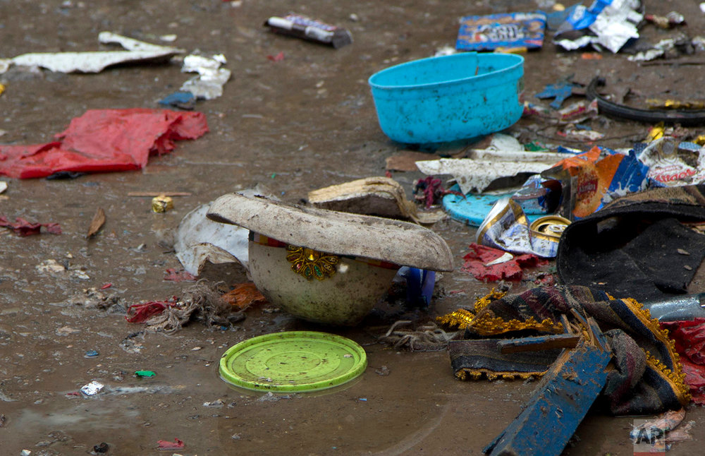 In this Feb. 11, 2018 photo, a carnival hat lies on the ground, muddied, the day after a gas canister exploded during a carnival parade in Oruro, Bolivia. (AP Photo/Juan Karita)