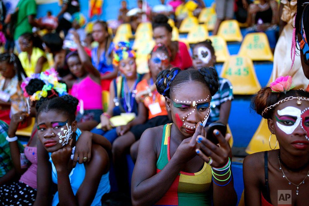 In this Feb. 12, 2018 photo, dancers wait for the start of Carnival celebrations at the National Stadium in Port-au-Prince, Haiti. (AP Photo/Dieu Nalio Chery)