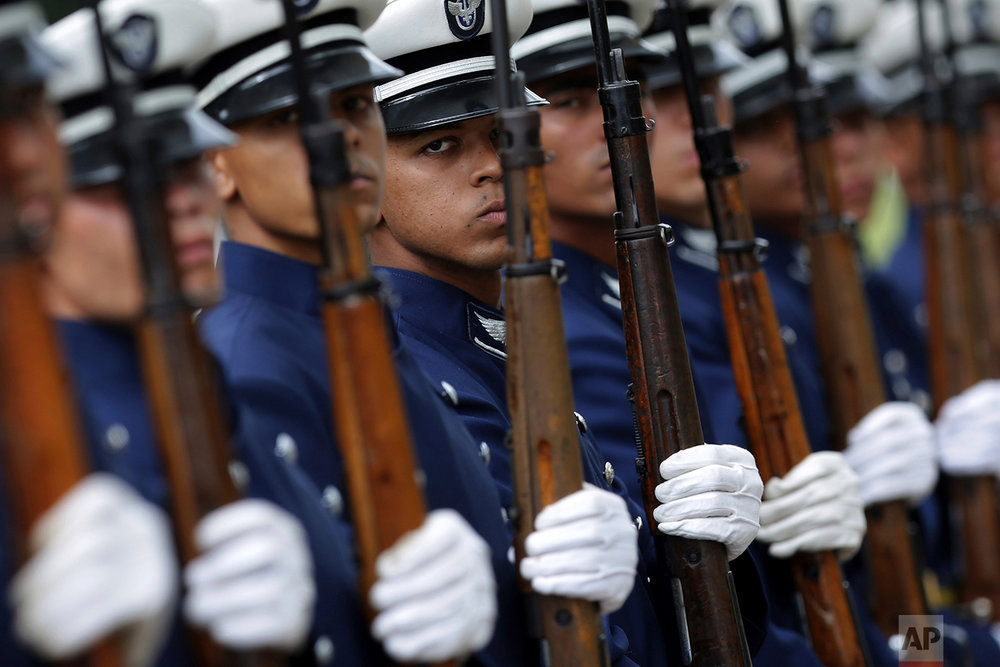 In this Feb. 22, 2018 photo, honor guards stand in formation before the arrival of Brazil's President Michel Temer for a meeting with the Defense Military Council in Brasilia, Brazil. (AP Photo/Eraldo Peres)