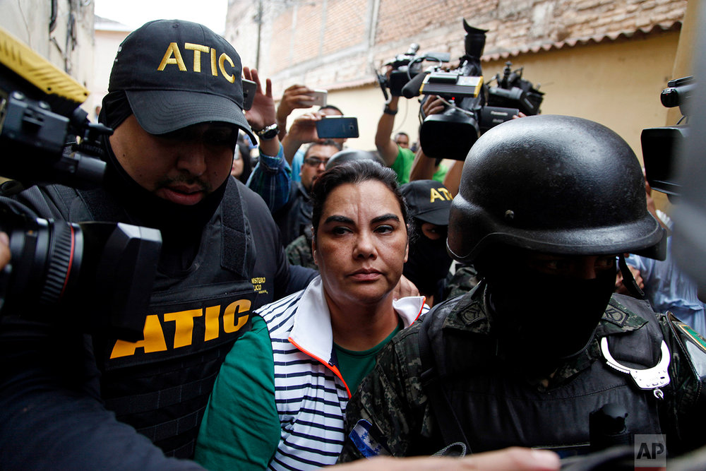 In this Feb. 28, 2018 photo, Honduras' former first lady Rosa Elena Bonilla, who was detained as part of a corruption probe, is escorted from a police station, in Tegucigalpa, Honduras. (AP Photo/Fernando Antonio)