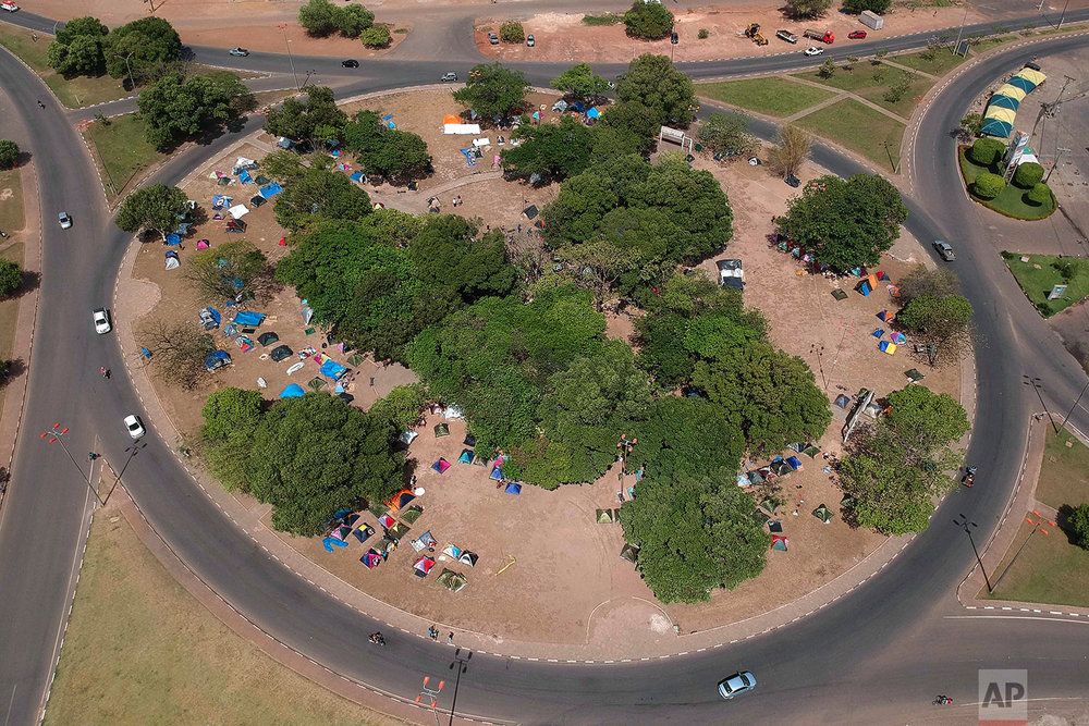 Tents set up by recently arrivals of Venezuelans dot Simon Bolivar Square in Boa Vista, Roraima state, Brazil, March 11, 2018. (AP Photo/Eraldo Peres)