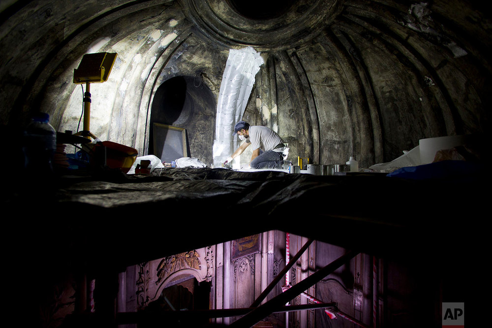 In this Monday, Sept. 19, 2016 photo, a Greek conservation team begin renovation of the Tomb of Jesus in the Church of the Holy Sepulchre in Jerusalem's Old City.  (AP Photo/Oded Balilty)
