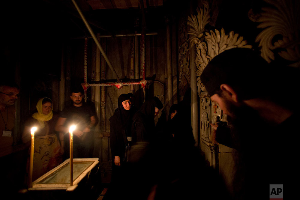Renovation of Jesus' tomb in the Church of the Holy Sepulchre in Jerusalem's old city in Jerusalem, Israel,  Monday, Sept. 19, 2016. (AP Photo/Oded Balilty)