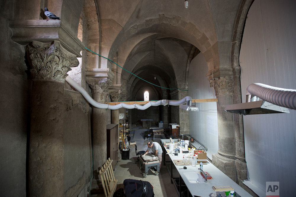 Renovation of Jesus' tomb in the Church of the Holy Sepulchre in Jerusalem's old city in Jerusalem, Israel,  Saturday, Oct. 8, 2016. (AP Photo/Oded Balilty)
