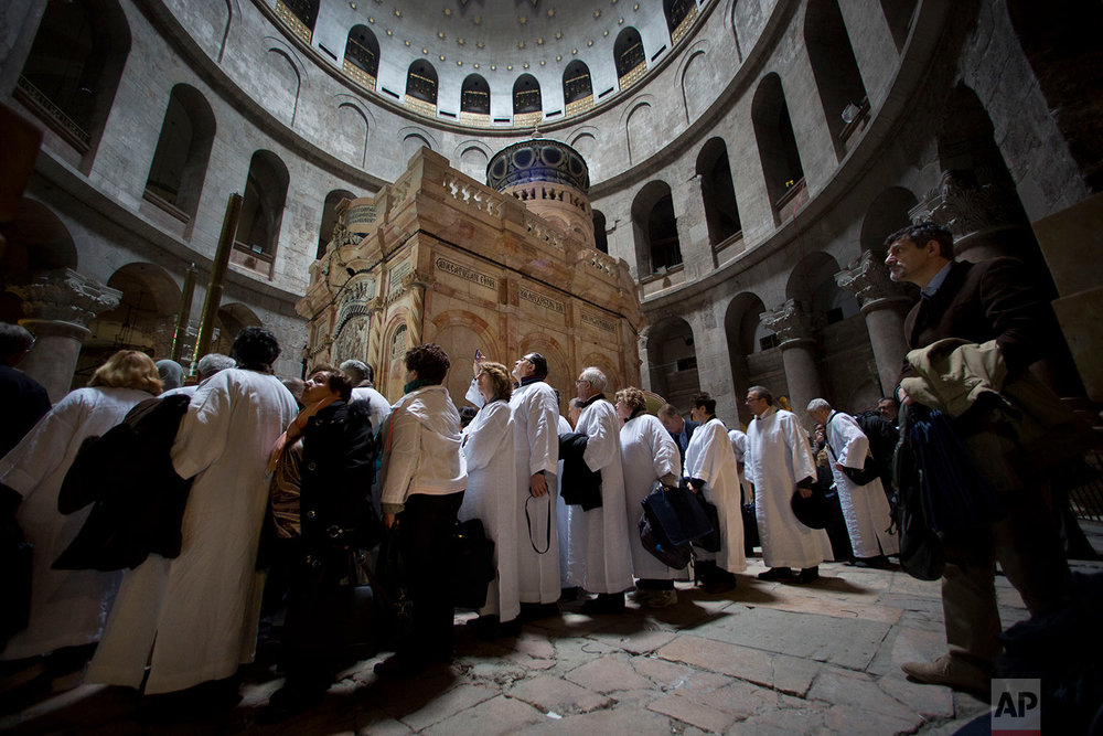 People line to to visit the renovated Edicule in the Church of the Holy Sepulchre in  Jerusalem's old city, Tuesday, March. 21, 2017. (AP Photo/Oded Balilty)