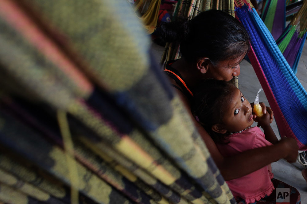 In this March 10, 2018 photo, a Warao woman and child from Venezuela, rest on a hammock at a shelter, in Pacaraima, Brazil. (AP Photo/Eraldo Peres)