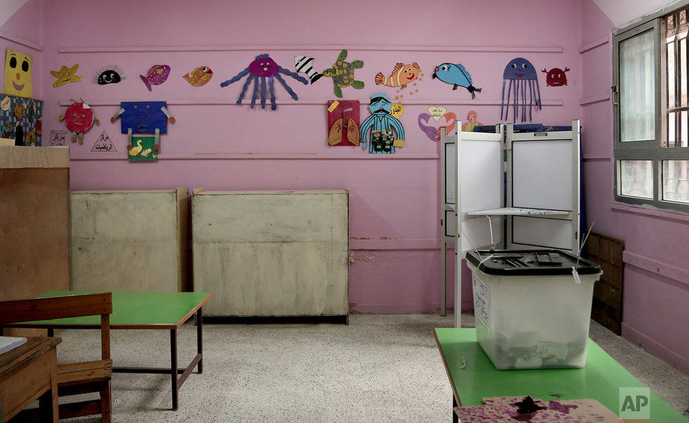 An empty polling station on the third day of the presidential election inside a polling station in the popular district of Shubra, Cairo, Egypt Wednesday, March 28, 2018. (AP Photo/Nariman El-Mofty)