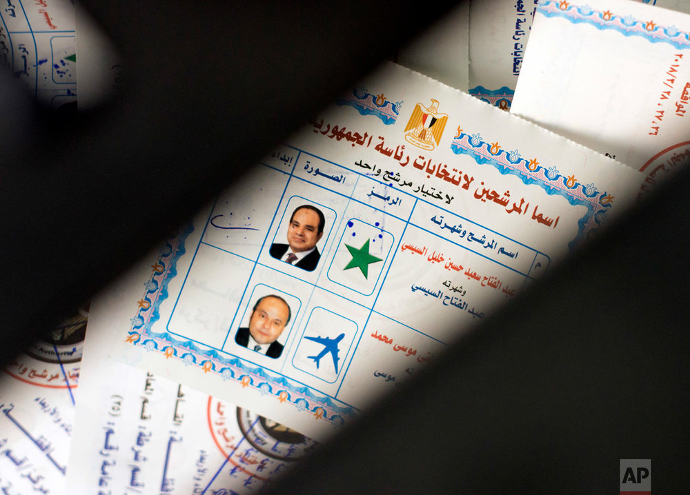 Ballots with photos and names of presidential candidates Abdel-Fattah el-Sissi, at top, and Moussa Mustafa Moussa, are visible inside a ballot box at a polling station, during the first day of the presidential election, in Cairo, Egypt, Monday, March 26, 2018. Egyptians head to the polls on Monday but the presidential election this time is not about who wins — that was settled long ago — but about how many people bother to cast ballots. (AP Photo/Amr Nabil)