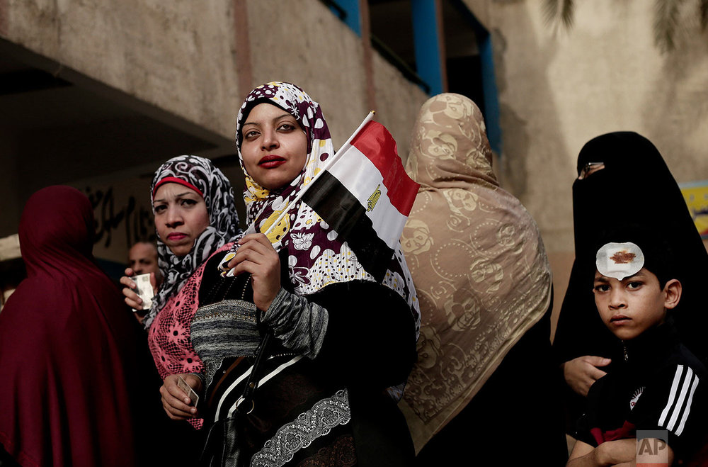 Women wait in line to vote outside a polling station at a school in the Omraniyah district of Giza, Egypt Tuesday, March 27, 2018. Turnout appeared low as Egyptians voted on the second day of an election that President Abdel-Fattah el-Sissi is virtually certain to win, after all serious rivals were either arrested or intimidated into dropping out. (AP Photo/Nariman El-Mofty)