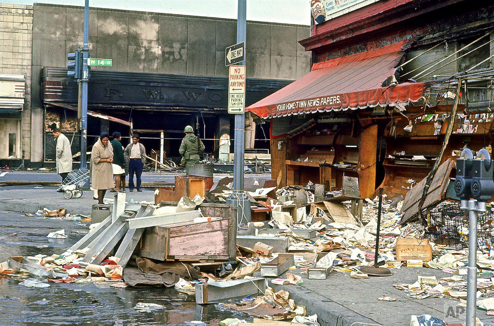 Torn-down newsstand on 14th and Kenyon Streets NW following rioting after the assassination of Dr. Martin Luther King, Jr., Saturday, April 6, 1968. (Photo/Darrell C. Crain/DC Public Library Specials Collections)