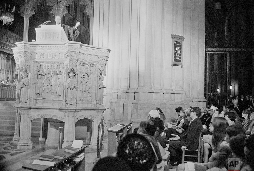 Rev. Dr. Martin Luther King, left, who heads the Southern Christian Leadership Conference, addresses a capacity crowd from the pulpit at the National Cathedral in Washington, D.C., March 31, 1968. King spoke from the Cathedral's Canterbury Pulpit and it would be his last Sunday sermon before he was assassinated later that week in Memphis. (AP Photo/John Rous)