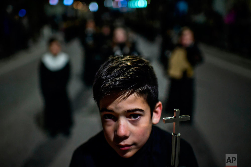 "A young penitent takes part in the procession of the ""Silencio del Santisimo Cristo del Rebate"" brotherhood, during Holy Week in Tarazona, northern Spain, Tuesday, March 27, 2018. Hundreds of processions take place throughout Spain during the Easter Holy Week. (AP Photo/Alvaro Barrientos)"