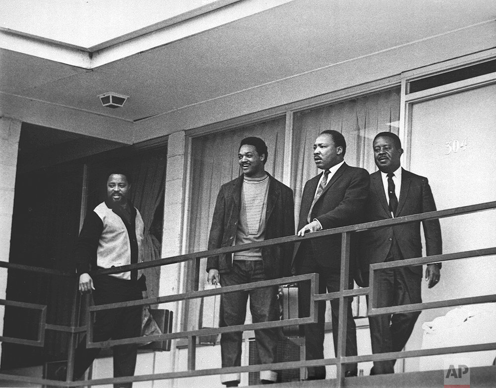 The Rev. Martin Luther King Jr. stands with other civil rights leaders on the balcony of the Lorraine Motel in Memphis, Tenn., on April 3, 1968, a day before he was assassinated at approximately the same place. From left are Hosea Williams, Jesse Jackson, King, and Ralph Abernathy. (AP Photo/Charles Kelly)
