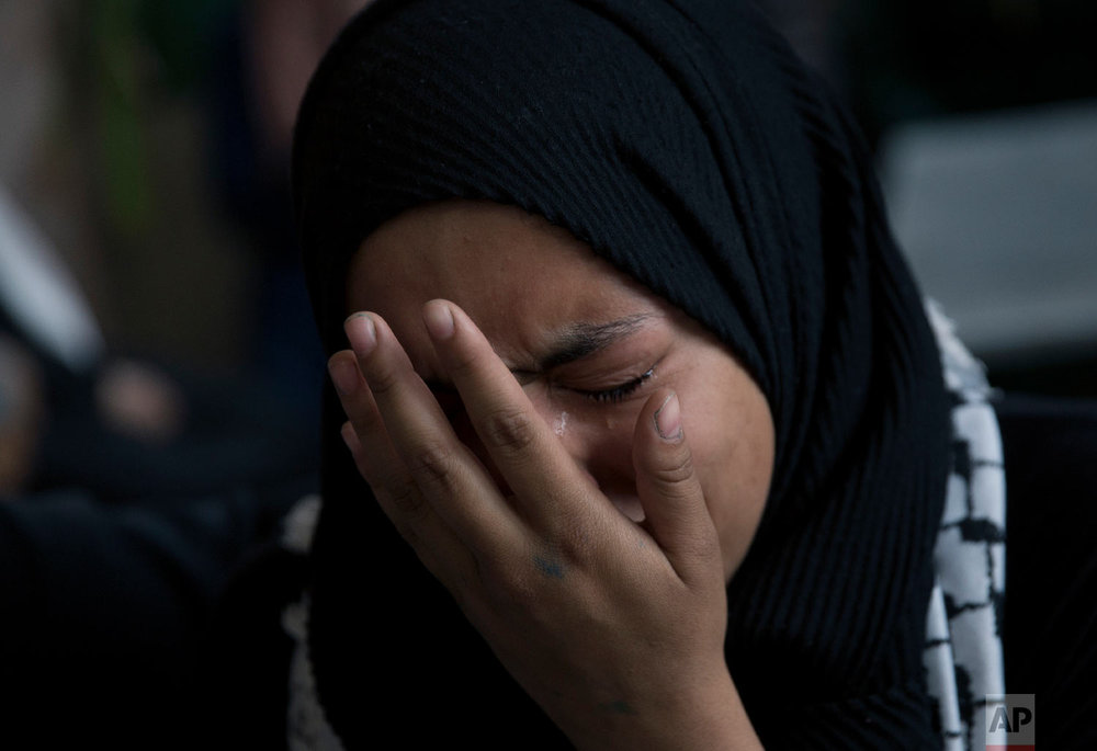 A woman weeps during the funeral of Palestinian Yasin Saradeeh, 33, who was killed by Israeli soldiers during an army raid in Jericho on February 22, 2018, in the West Bank city of Jericho, Thursday, March 29, 2018. (AP Photo/Nasser Nasser)