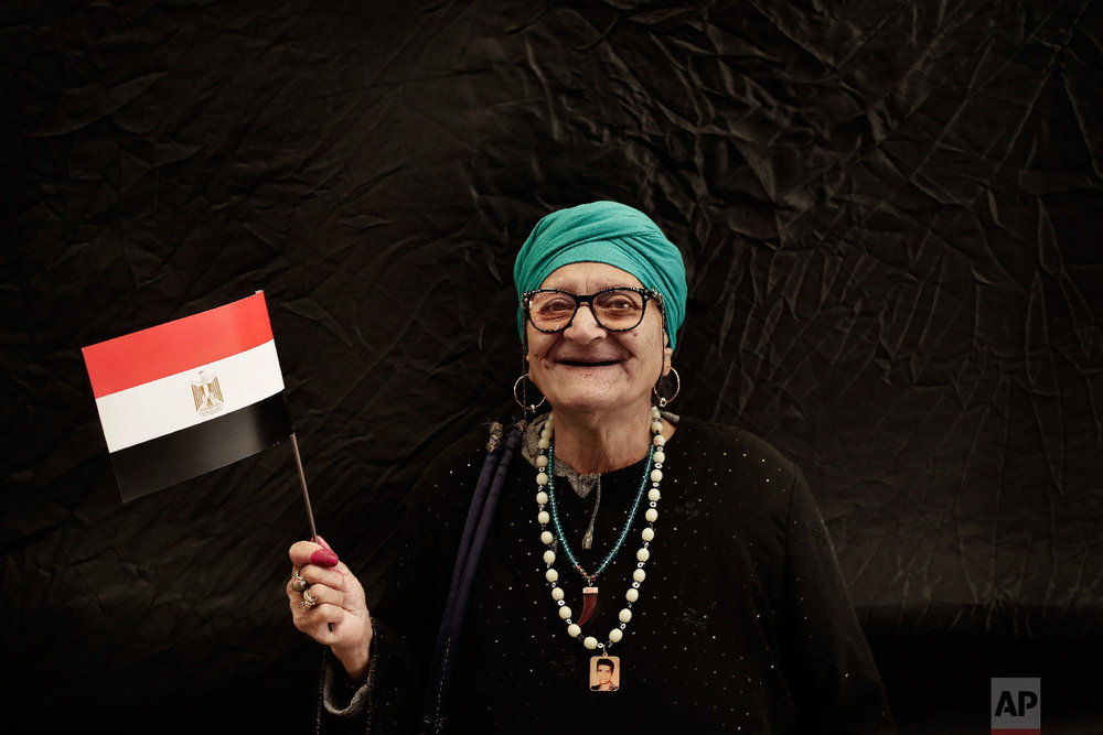 A woman poses for a photo after voting during the first day of the presidential election outside a polling site in Cairo, Egypt, Monday, March 26, 2018. (AP Photo/Nariman El-Mofty)