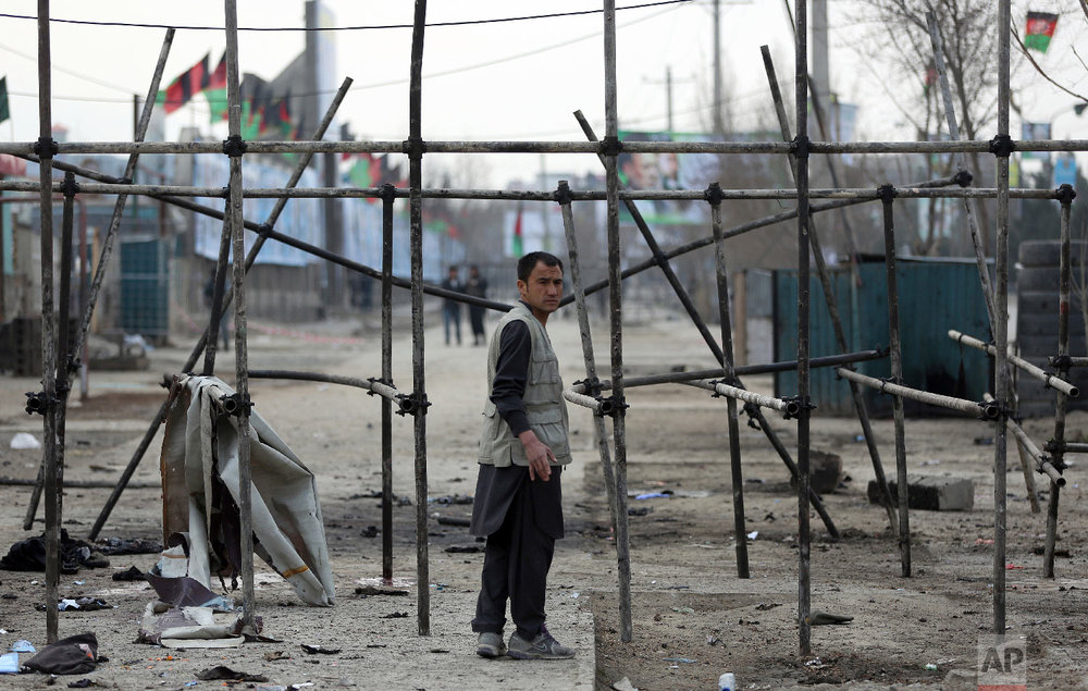 A man stands at site of a suicide attack in Kabul, Friday, March 9, 2018. (AP Photo/Massoud Hossaini)