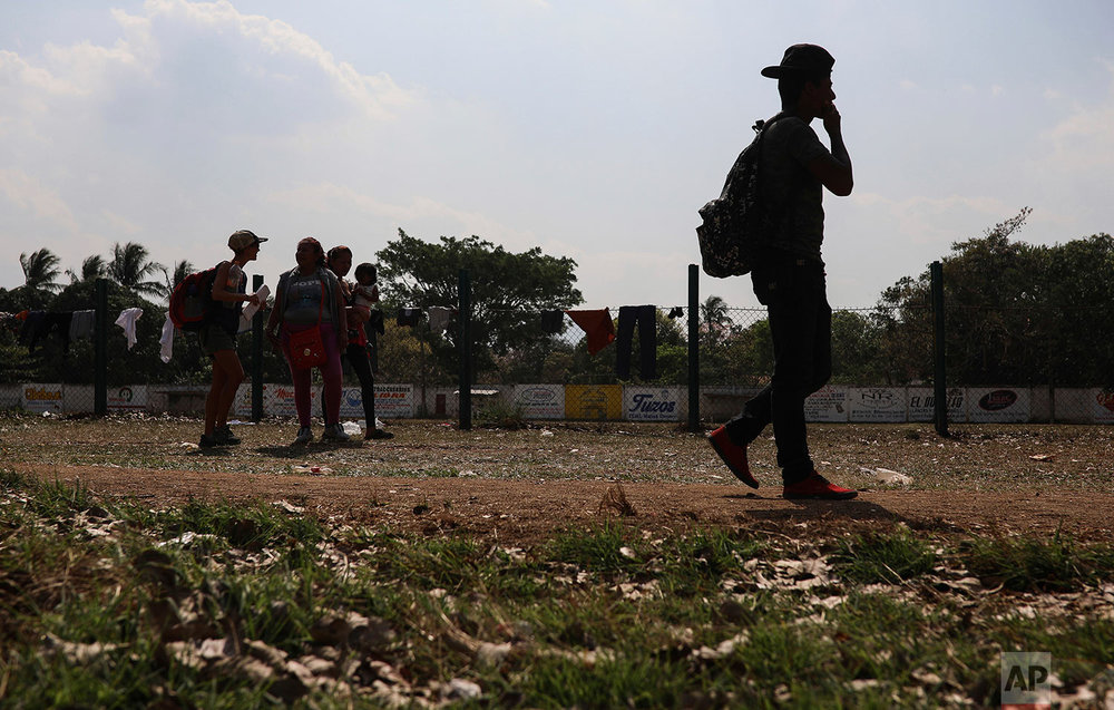 Central American migrants participating in the annual Migrant Stations of the Cross caravan mill around a sports center during the group's stop in Matias Romero, Oaxaca state, Mexico, Monday, April 2, 2018. (AP Photo/Felix Marquez)