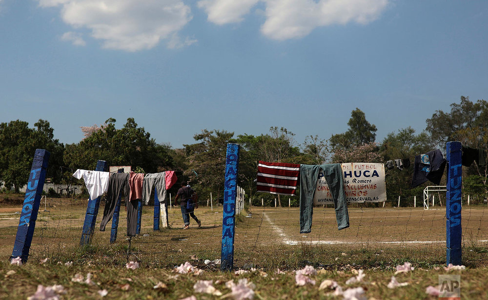 Clothing hangs to dry at a sports center being used as a base for a few days by a caravan of Central American migrants who are part of the Migrant Stations of the Cross caravan in Matias Romero, Oaxaca state, Mexico, Monday, April 2, 2018. (AP Photo/Felix Marquez)