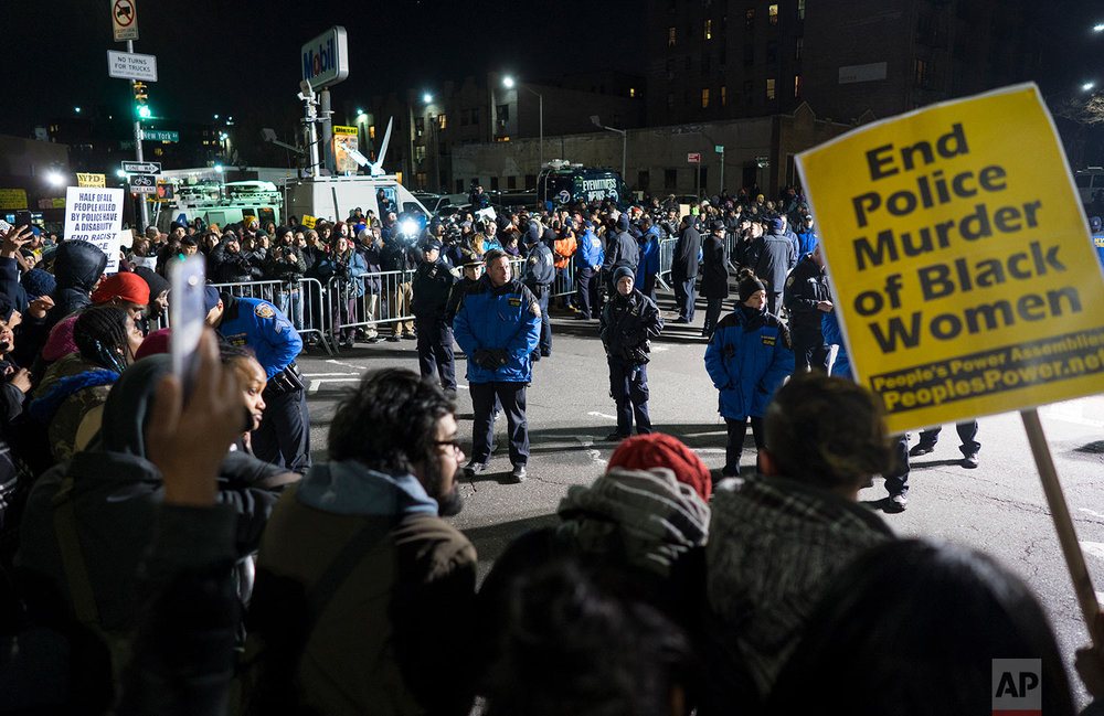 Hundreds rally at the New York Police Department's 71st Precinct on Empire Boulevard and New York Avenue to protest Wednesday's fatal police shooting of Saheed Vassell, a 34-year-old father of a teenage son, Thursday, April 5, 2018, in the Brooklyn borough of New York. (AP Photo/Craig Ruttle)