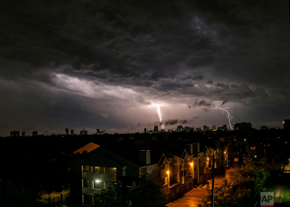 Lightning strikes near the Medical Center early Wednesday, April 4, 2018, in Houston. Strong winds that swept through the Houston area, caused damage including a hangar that collapsed at one of the city's airports, damaging planes and scattering debris. (Elizabeth Conley/Houston Chronicle via AP)
