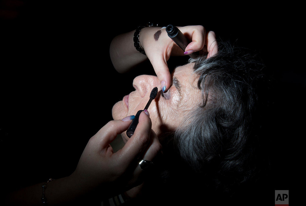 Holocaust survivor Rosie Mordo, 85, gets her makeup ready during a Beauty Heroines event in Ramat Gan, Israel, Monday, April 9, 2018.  (AP Photo/Oded Balilty)
