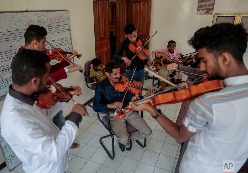 Abdullah El-Deb'y, center, teaches his students during a music class at the Cultural Centre in Sanaa, Yemen on Sunday, April 8, 2018. (AP Photo/Hani Mohammed)