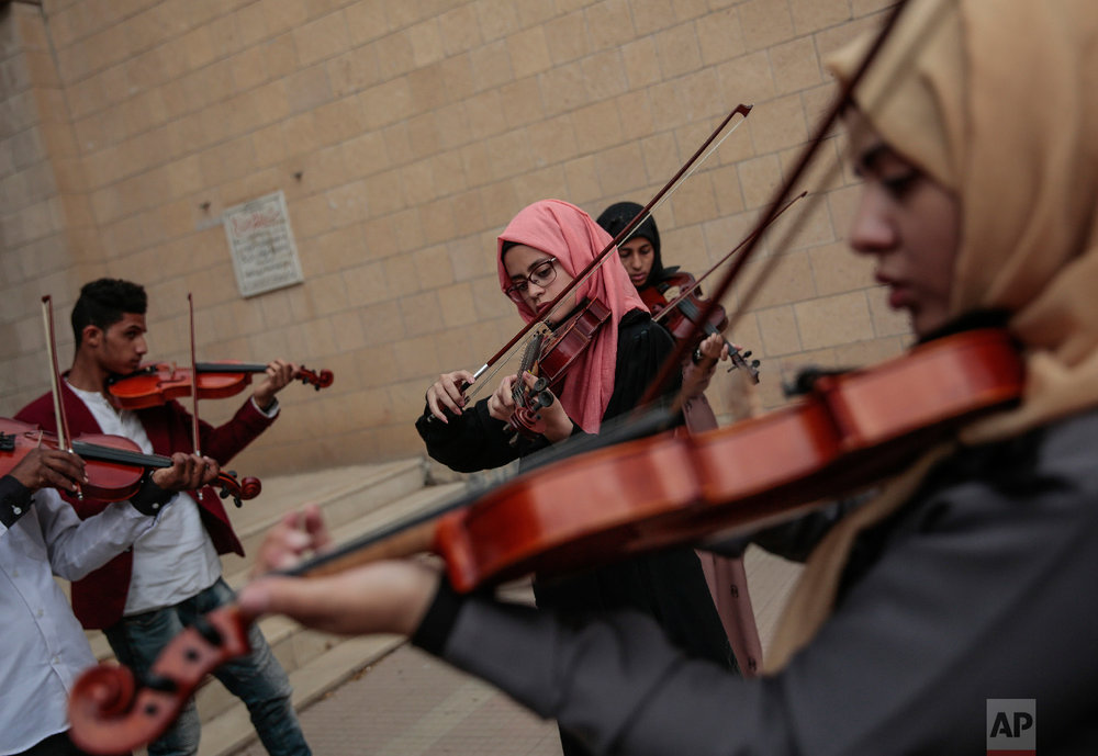 Yemeni music students play violins during a music class at the Cultural Centre in Sanaa, Yemen on Sunday, April 8, 2018. (AP Photo/Hani Mohammed)