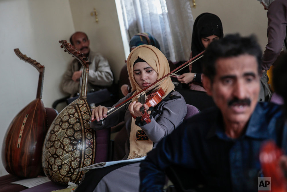 A female Yemeni music student plays the violin during a music class at the Cultural Centre in Sanaa, Yemen on Sunday, April 8, 2018. (AP Photo/Hani Mohammed)
