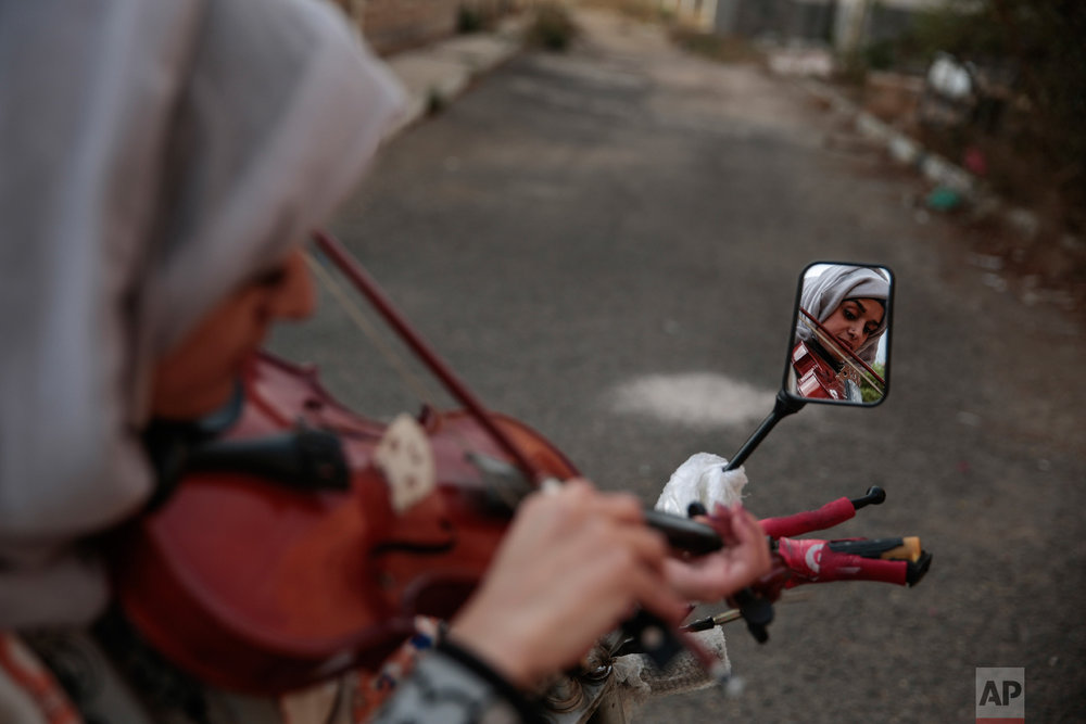 A female Yemeni music student practices playing the violin during a music class at the Cultural Centre in Sanaa, Yemen on Sunday, April 8, 2018. (AP Photo/Hani Mohammed)