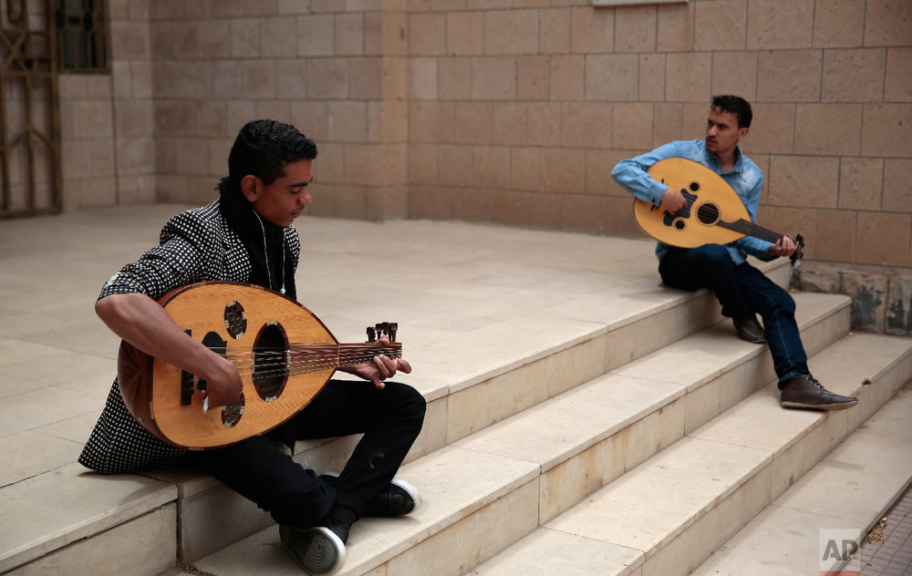 Yemeni music students practice playing the musical instruments during a music class at the Cultural Centre in Sanaa, Yemen on Saturday, April 7, 2018. (AP Photo/Hani Mohammed)