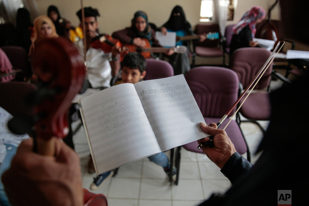 Abdullah El-Deb'y, a music trainer teaches his students during a music class at the Cultural Centre in Sanaa, Yemen on Sunday, April 8, 2018. (AP Photo/Hani Mohammed)