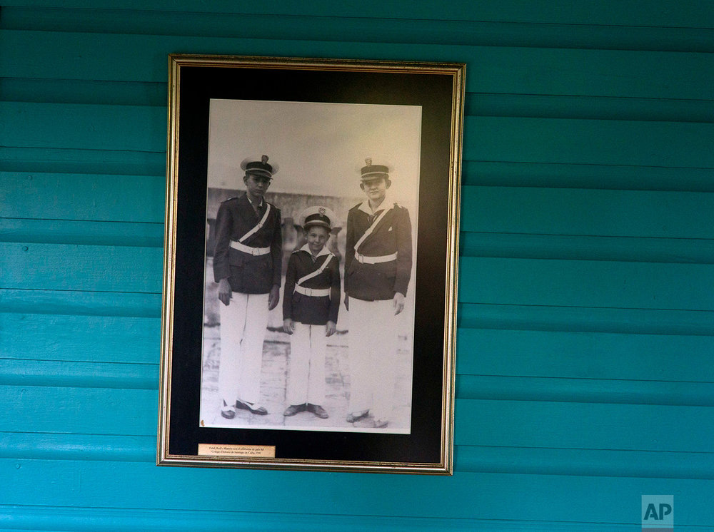 A family photograph of the Castro brothers, from left, Fidel, Raul and Ramon, on the wall of the room they shared as children in Biran, Cuba, June 10, 2016. Biran is the birthplace of revolutionary leader Fidel Castro and his brother, President Raul Castro. (AP Photo/Ramon Espinosa)