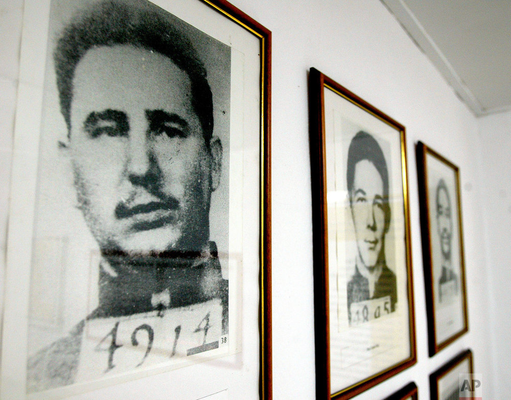 The 1953 mug shots of Fidel Castro, left, and his brother Raul, are framed and on display at the Siboney Museum, the former farmhouse where they planned the attack on the Moncada military barracks, near Santiago, Cuba, July 19, 2003. Freed in an amnesty, the two brothers fled to Mexico and began recruiting a tiny rebel army. (AP Photo/Jose Goitia)