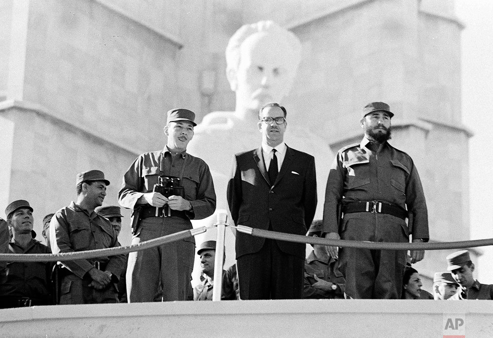 Cuban Prime Minister Fidel Castro, right, President Osvaldo Dorticos, center, and Armed Forces Chief, Commander Raul Castro, watch a military parade in Havana, Jan. 2, 1966. Dorticos, who was named Cuba's president in 1959, resigned in 1976. Fidel officially became Cuba's president ruling for more than five decades. (AP Photo)