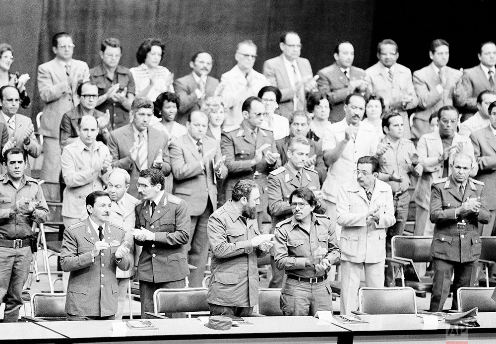 Cuba's Defense Minister Raul Castro, from left, his brother President Fidel Castro and Daniel Ortega, coordinator of the Junta of National Reconstruction of Nicaragua, attend a celebration marking the 20th anniversary of the failed military invasion Bay of Pigs, in Havana, April 21, 1981. The Castro brothers backed revolutionary movements in many parts of Latin America, including Nicaragua where Cuban-inspired revolutionaries toppled the Somoza dictatorship in 1979. (AP Photo/Charles Tasnadi)