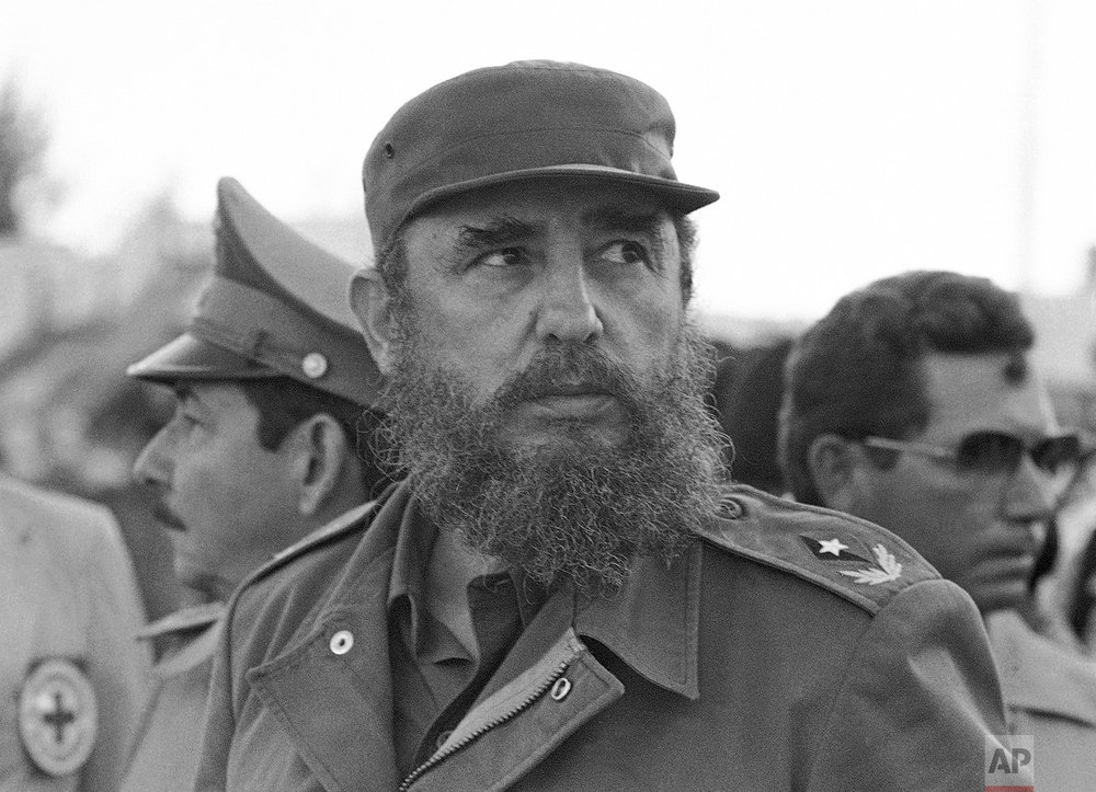 Cuban President Fidel Castro and his brother Raul, head of the Cuban Armed Forces, watch as the first group of Cubans returns home from Grenada, in Havana, Nov. 2, 1983. Raul, who has spent most of his life by the side of his larger-than-life brother, has always seemed more comfortable behind the scenes. (AP Photo/Charles Tasnadi)