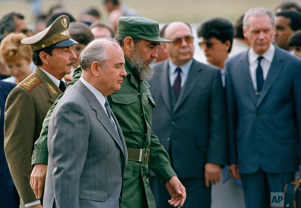 Cuban President Fidel Castro and his brother, Defense Minister Gen. Raul Castro, left, escort Soviet Union President Mikhail Gorbachev during a welcoming ceremony at the airport, in Havana, April 3, 1989. Life in Cuba changed dramatically after the fall of the Soviet Union in 1991 resulting in a crisis known as the Special Period. (AP Photo/J. Scott Applewhite)