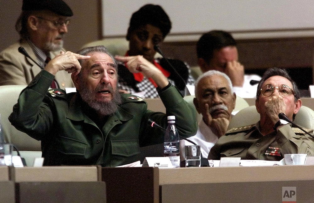 Cuban leader Fidel Castro delivers a speech seated next to his brother, Defense Minister and first Vice President Raul Castro, during a final session at the National Assembly, in Havana, Dec. 20, 2001. Part of Fidel's nearly five-decade rule was characterized by meandering, hours-long speeches. (AP Photo/Jose Goitia)