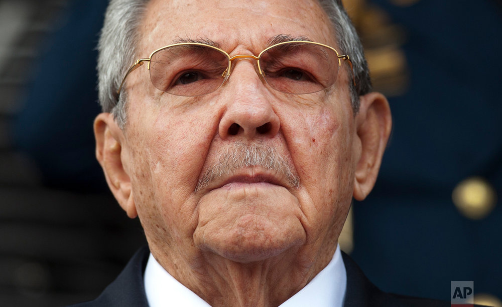"Cuba's President Raul Castro listens to the playing of national anthems during his welcome ceremony at the Miraflores presidential palace in Caracas, Venezuela, March 17, 2015. Castro will step down as president on April 19, 2018 after a decade in office. However Castro will remain first secretary of the Communist Party, considered the country's ""highest guiding force."" (AP Photo/Ariana Cubillos)"