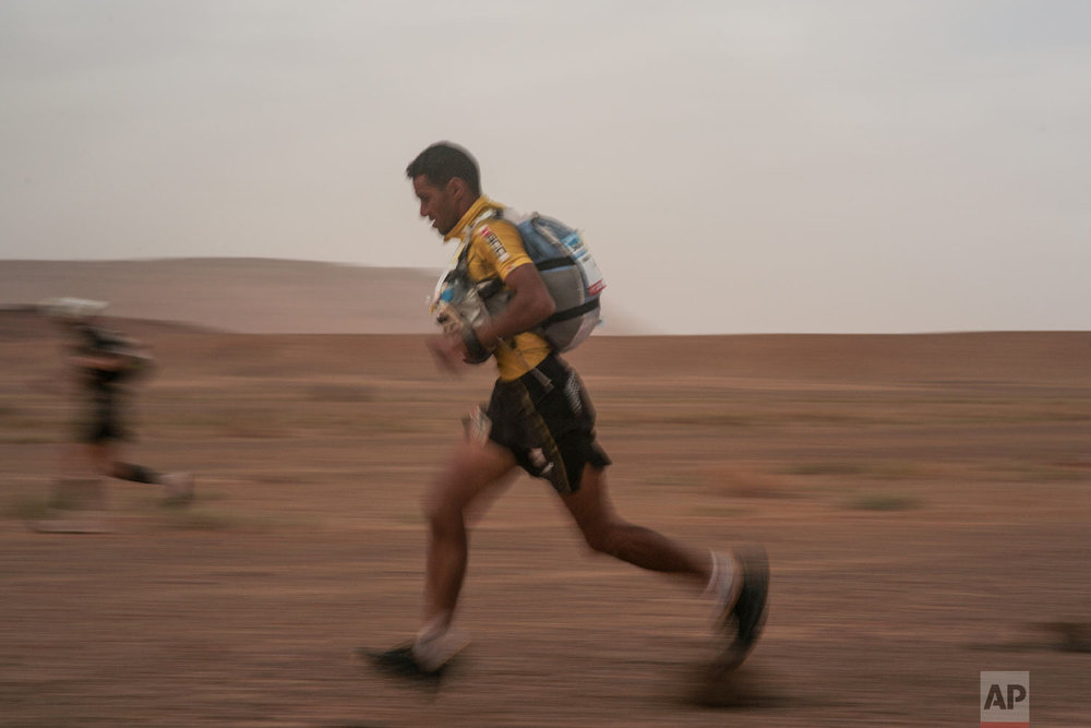 Rachid El Morabity, the 1st place winner, crosses a checkpoint during the 33rd edition of Marathon des Sables, in the Sahara desert, near Merzouga, southern Morocco, Friday, April 13, 2018. (AP Photo/Mosa'ab Elshamy)