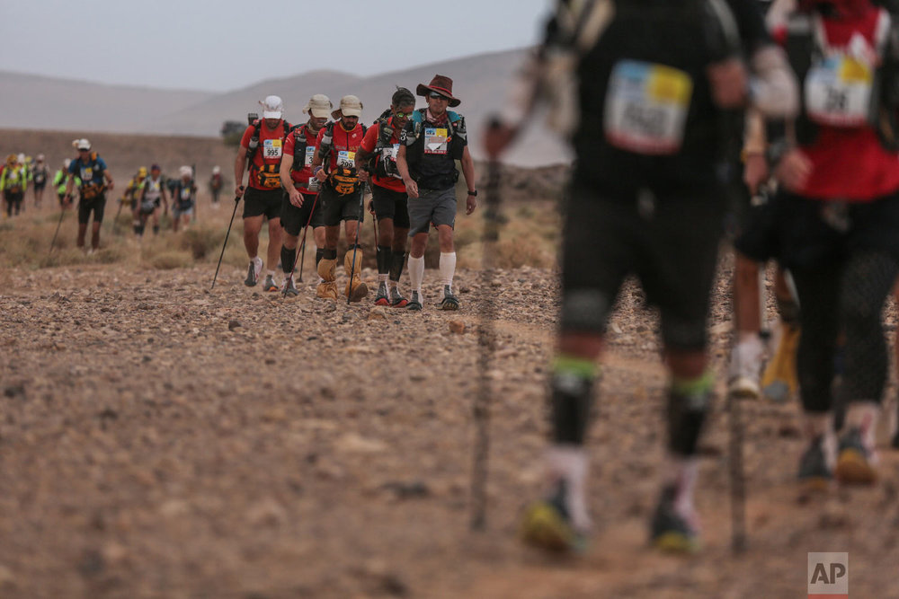 Competitors take part in stage 5 of the 33rd edition of Marathon des Sables, in the Sahara desert, near Merzouga, southern Morocco, Friday, April 13, 2018. (AP Photo/Mosa'ab Elshamy)