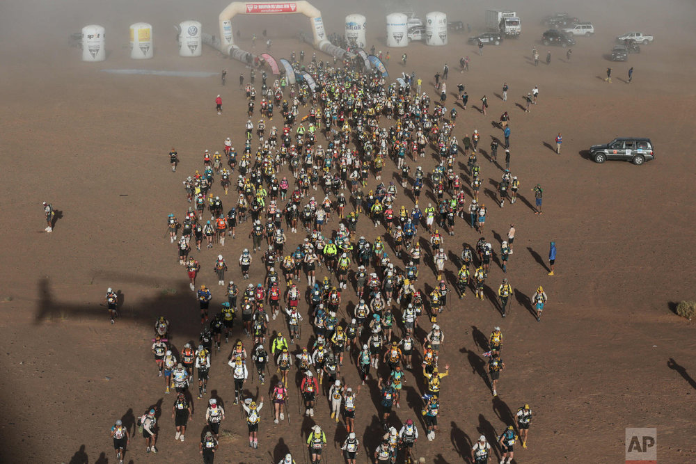 Competitors take part in in the 33rd edition of Marathon des Sables, in the Sahara desert, near Merzouga, southern Morocco, Friday, April 13, 2018. (AP Photo/Mosa'ab Elshamy)