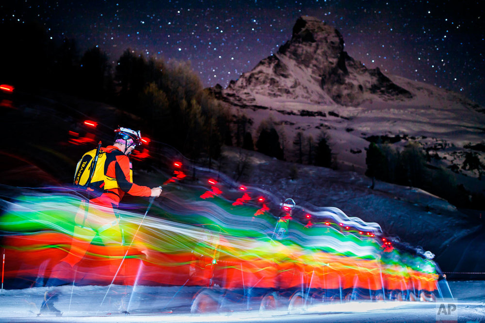 In this photo taken with slow shutter speed, competitors climb in front of the Matterhorn mountain at the start of the 21st Glacier Patrol race in Stafel outside the ski resort of Zermatt, Switzerland on April 17, 2018. The Glacier Patrol (Patrouille des Glaciers in French), organized by the Swiss Army, takes place from April 17 to 21. Highly-experienced hiker-skiers trek for over 53km (3994m ascent and 4090m descent) along the Haute Route along the Swiss-Italian border from Zermatt to Verbier. (Valentin Flauraud/Keystone via AP)