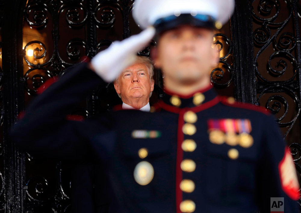 President Donald Trump waits for the arrival of Japanese Prime Minister Shinzo Abe at Trump's private Mar-a-Lago club, Tuesday, April 17, 2018, in Palm Beach, Fla. (AP Photo/Pablo Martinez Monsivais)
