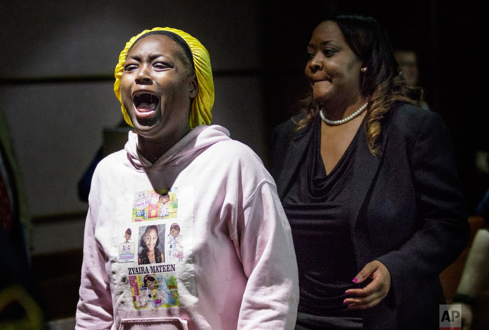 Jasmine Mateen, mother of bus crash victim Zyaira Mateen, shouts as she is escorted from the courtroom during a sentencing hearing for Woodmore bus driver Johnthony Walker in Judge Don Poole's courtroom at the Chattanooga-Hamilton County Courts Building, Tuesday, April 24, 2018, in Chattanooga, Tenn. Walker, who was at the wheel in a wreck that killed six children, was sentenced to four years in prison for criminally negligent homicide. (Doug Strickland/Chattanooga Times Free Press via AP)