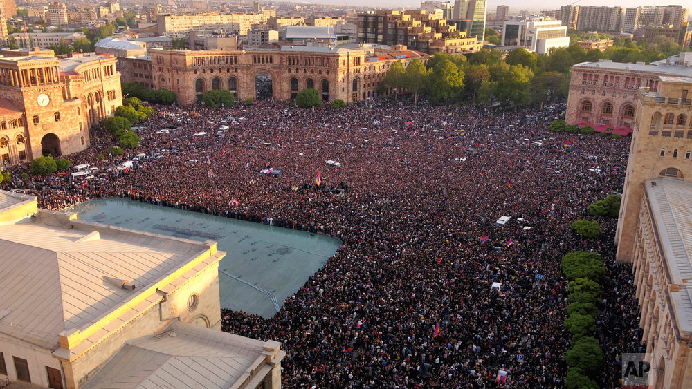 Opposition demonstrators gather in the Republic Square celebrating Armenian Prime Minister's Serzh Sargsyan's resignation in Yerevan, Armenia, Monday, April 23, 2018. Sargsyan resigned unexpectedly Monday to quell massive anti-government protests over what critics feared was his effort to seize power for life. (Davit Abrahamyan/PAN Photo via AP)